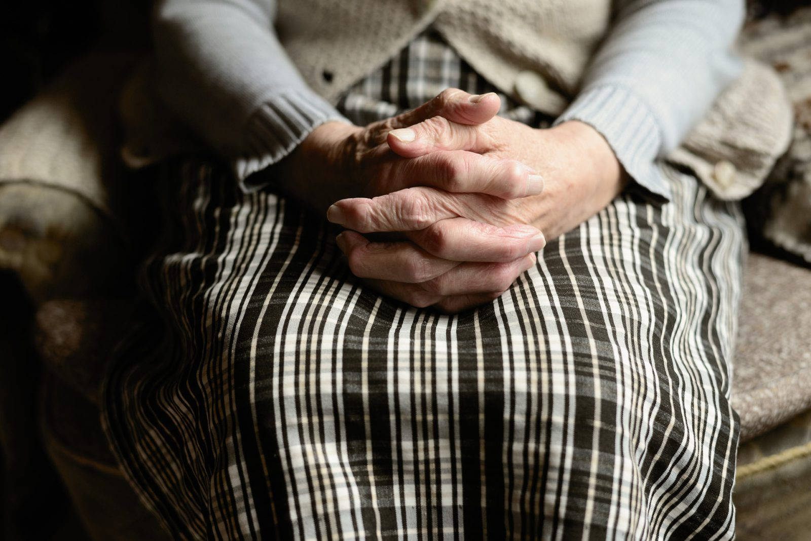 Hands of elderly woman clapsed